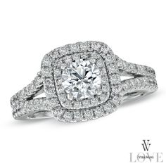 Vera Wang LOVE Collection engagement ring from Zales.com. This is more of a blingy fantasy ring, but I like the way the pave diamonds create a cushion shape around the center round diamond :)