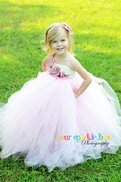 Soft pink and white flower girl dress for pink themed wedding.