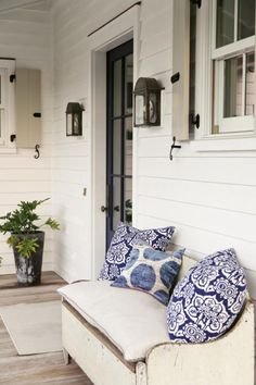 Tone on tone exterior paint. Shutter hardware, navy blue door The Art of Summer | Charleston Magazine #porch #Blue&white