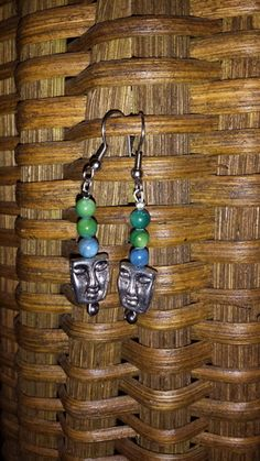 Faceless - Green & Blue - The profit from the sale of these earrings helps to rescue a victim of human trafficking AND money is contributed to eradicate poverty!