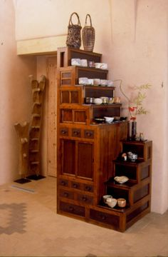 """is this an actual tansu or inspired by one?  ( """"this would fit in a tiny space"""" )"""