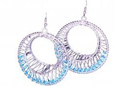 Simple yet elegant, these stylish earrings showcase a classic hoop design. Crafted on white metal, these earrings shine with a highly polished finish. Each earring is white metal framed with colorful red and blue plastic beads. Round in shape, these hoop earrings can be worn both with casual as well as formal wears.  $12  http://www.craftmontaz.com/products/silver-wired-hoop-earrings-info.html