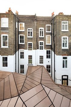copper-roofed office extension to georgian townhouses in london / emrys architects.