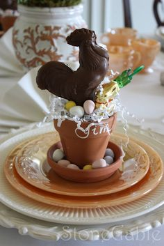 Instead of #Easter baskets, little personalized #terracotta #pots in saucers are filled with a chocolates and other sweet goodies