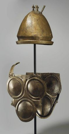 A SUITE OF ETRUSCAN BRONZE ARMOR CIRCA 500-450 B.C. & 5th/4th century B.C. An Italic set of armour. Bronze attic Italic ...