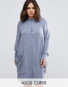 Buy it now. ASOS CURVE Shirt Dress with Drape Pockets - Blue. Plus-size dress by ASOS CURVE, Textured fabric, Grandad collar, Button placket, Functional pockets, Stepped hem, Relaxed fit, Machine wash, 100% Viscose, Our model wears a UK 18/EU 46/US 14 and is 173cm/5'8 tall. ABOUT ASOS CURVE Say goodbye to awkward-fitting plus-size fashion with our ASOS CURVE collection. Giving shout-outs to denim, occasionwear and jumpsuits, our London-based design team nail your new-season fashion goals…