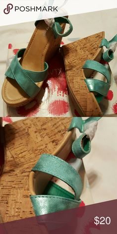 Metallic Teal Crossover Wedges Brand new 4.5 inch Wedges with a 1.25 inch toe platform. Top is metallic synthetic material and heel is a heany cork. Beauty Heel Shoes Wedges