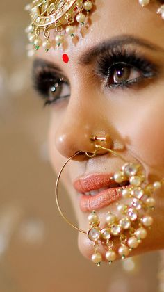 Perfect finishing to a bridal look is given by stunning nose rings! Book the best makeup artist now with BookEventZ to get the perfect bridal look on THE DAY! Bridal Poses, Bridal Photoshoot, Bridal Shoot, Indian Wedding Makeup, Indian Wedding Jewelry, Indian Makeup, Bridal Jewellery, Indian Weddings, Indian Bridal Photos