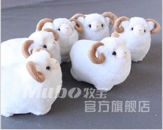 Image from http://i01.i.aliimg.com/wsphoto/v0/436704965_2/Lovely-cute-plush-toy-goat.jpg.