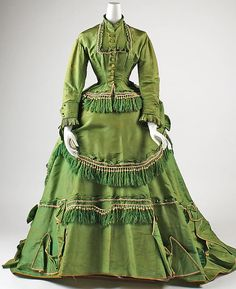 Dress Date: 1868 Culture: American Medium: silk Dimensions: (a) Length at CB: 24 1/2 in. (62.2 cm) (b) Length at CB: 60 in. (152.4 cm) (c) Length at CB: 41 in. (104.1 cm) Credit Line: Gift of Mrs. William R. Witherell, 1953 Accession Number: C.I.53.72.1a–c