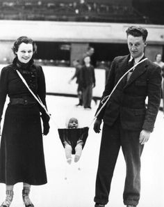 Ice skating with your baby suspended between you. Nothing could possibly go wrong here.