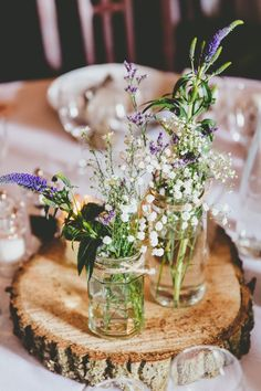 Wildflowers Centrepiece Log Jars Twine Purple White Relaxed Fun Rustic Countryside Barn Wedding http://www.paulunderhill.com