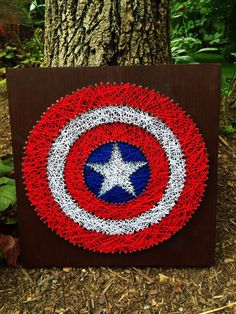 Captain America String Art. Measures 12x12. Board hangs flush - no hanging hardware required.