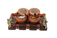 An exquisite and ethnic tray with two bowls. Each bowl with a serving spoon. This tray can be used for a variety of purposes. Adds a wow to your table décor.