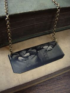 Victorian tintype necklace with hand-drawn feather by Luminoddities $38.00