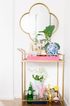 Colorful Bar Cart decor in this colorful dining room tour on Megan Martin Creative. Target bar cart, quatrefoil mirror, fiddle fig plant, chinoiserie, white walls, bright home decor, colorful home
