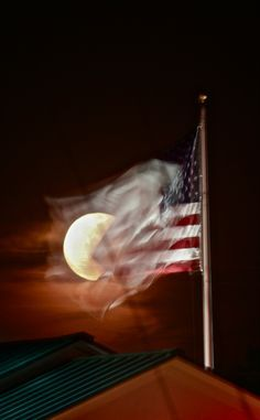 AMERICAN FLAG (AROUND) THE MOON | A night after Super Moon the lunar show continues with a little help from Old Glory at the BankPlus on Spillway/Northshore ...