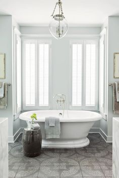 "The Master Bath - Nashville Idea House Tour - Southernliving. ""Laid out in a pattern, this Ann Sacks tile gives the same graphic punch as a painted floor but is much more practical for a bath,"" says Phoebe. She continued the tile into the large closet and dressing area so that the two connected spaces would feel cohesive."