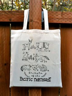 I LOVE THIS TOTE! I have one :] Animals of the PNW Tote by thelittlecanoe on Etsy, $18.00