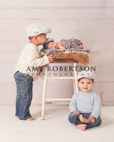 newborn with siblings. This picture makes me want precious little boys!