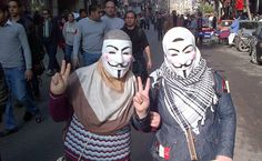 Egyptian women wear masks during a protest