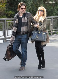 Rachel Zoe and husband Rodger Berman shopping in West Hollywood http://www.icelebz.com/events/rachel_zoe_and_husband_rodger_berman_shopping_in_west_hollywood/photo3.html