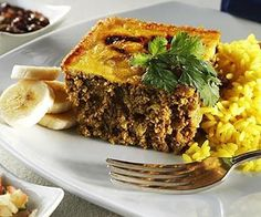 """Make vegan! Pronounced """"bo-boo-tea"""", this is a sweet curried meatloaf (can be made with ground beef or lamb) with a baked egg mixture topping. This delicious, traditional South African dish incorporates fruit (gr Healthy Ground Turkey, Ground Turkey Recipes, Ground Beef, South African Dishes, South African Recipes, Indian Recipes, Healthy Meatloaf, Meatloaf Recipes, Gourmet Recipes"""