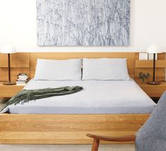 Master bedroom A bed with built-in night tables maximizes space. The palette of Michael Batty's Becoming Series works beautifully with the bed linens and armchair fabric.