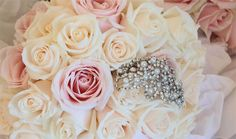 Pink and cream rose bouquet with added embellishment for a vintage touch - by Louise Avery Flowers