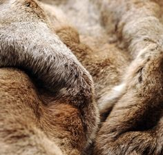 delicious toffee shades - fur throw by Nicky Dobree