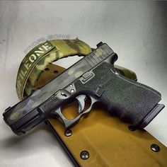 Stippled Glock 19 with dark multicam cerakoted slide Weapons Guns, Guns And Ammo, Glock Stippling, Glock 19 Gen 4, Custom Glock, Cool Tools, Self Defense, Tactical Gear, Firearms