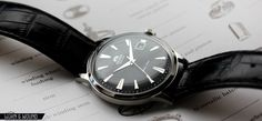 Orient Bambino with steel case and black dial - $149.00