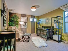 Stripes add pizazz to this gender-neutral nursery and help tone down the mustard-yellow walls. A metal shelf provides storage crib-side, while a flokati rug offers comfort and style underfoot.