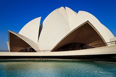 The Baha'i House of Worship, more commonly known as the Lotus Temple due to its flowerlike shape, designed by Iranian-Canadian architect Fariborz Sahba. Lotus Temple, Travel Photographer, Iranian, Worship, My House, Shape, Building, Places, Design