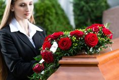 Mourning Woman at Funeral with coffin. Mourning woman on funeral with red rose s , Funeral Bouquet, Funeral Flowers, Funeral Costs, White Carnation, Funeral Flower Arrangements, Different Types Of Flowers, Popular Flowers, Flower Meanings, Pink Carnations