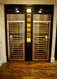 Thermador Wine Columns with custom Cigar Humidor adorned by LED lighting.  That's the nuts!