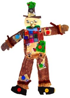 Paper Scarecrow Craft:  Using craft paper, scrapes of fabric, and buttons, the children could make a unique scarecrow of their own. scarecrow craft