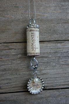 Wine Cork Necklace...with a bottle cap charm! Would like as an ornament.