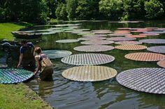Have you moved recently? Are you of the age, say, late 20s, early 30s, where at somepoint in your life owning, buying, and collecting CDs was something you did so now you have over a thousand just taking up space? Well, British artist Bruce Monro has found a place for 65,000 recycled Cds: make waterlilies. Why didn't we think of that?