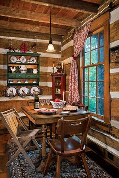 The eating area is just off the kitchen and looks out onto the wooded backyard. Many of the furnishings came from yard and estate sales. All the windows are single pane, and although they're not old, they feature true divided lights to provide historic accuracy.