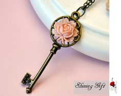 Antiqued Brass Key Necklace, with resin rose flower. $2.99, via Etsy.