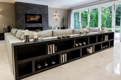 Long Low Bookcase Family Room Contemporary with Art Glass Lighting Blown