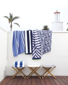 Poolside living | Beach Towels and Teak Camp Stools via Serena & Lily