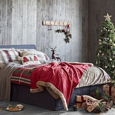 Like the idea of having a cabin-inspired hideaway at home? Take your style cue from this cosy bedroom filled with key pieces from @Sainsburys new Winter Cottage collection. Snuggle up with a luxurious faux fur-trimmed blanket and pile festive cushions featuring traditional prints in merry colours on your bed – then dive in. #sainsburyshome #sponsored http://trib.al/Zy3kUN5