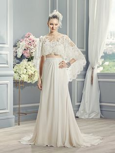 Moonlight Style J6362 A flowing chiffon skirt paired with a French lace capelet makes this two-piece, trumpet wedding dress perfect for any country wedding.