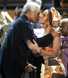 Nelson Mandela kisses Beyonce Knowles at the Nelson Mandela AIDS benefit concert in Cape Town, 2003