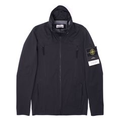 Essential new Light Soft Shell SI Check Grid Jacket from Stone Island. The Light Soft Shell is a 2.5 layer performance fabric. The polyester jersey outer face is laminated to a breathable, water and wind resistant inner membrane, printed with the Stone Island check grid. The material construction bestows the garment with excellent flexibility and comfort.