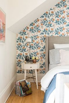 The side tables from West Elm are perfect with wallpaper from Hygge & West.
