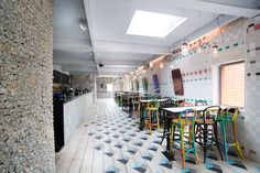Dishoom - flooring, rolled up newspaper wall, wooden stools
