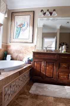 A view of the bathroom sink and tub. #bathroomdesign